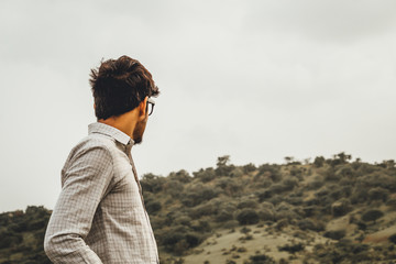 Man wearing sunglasses in front of the hills