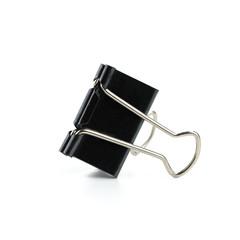 Black binder clip on white background - Image