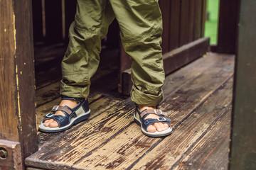children's orthopedic shoes on the boy's feet