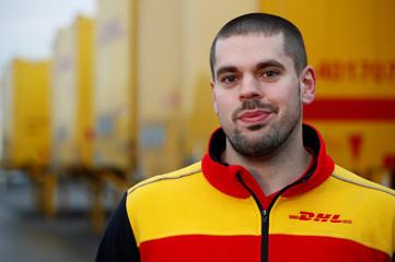 Klankert, a 27-year-old truck driver of German postal and logistics group Deutsche Post DHL poses for a picture during a Reuters interview in Sehlem