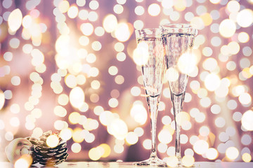 Fototapete - Two glasses of champagne with Christmas toys. Festive lights bokeh background