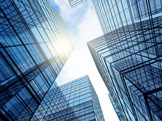 View of high rise glass building and dark steel window system on blue clear sky background,Business concept of future architecture,looking up to the sun light on the top of building. 3d render Fototapete
