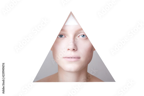 Beautiful girls face in a triangle with the triangle on her