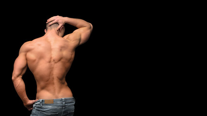 Man's strong fitness back isolated on dark background