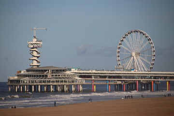 Pier and Ferris wheel at the beach of Scheveningen close to The Hague on the North sea beach