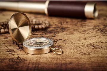 Vintage compass and spyglass telescope  on old map  - Explorer  concept