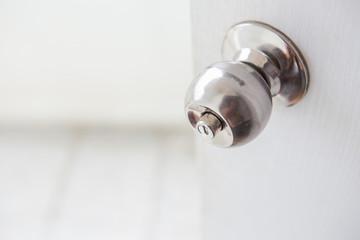 Door knob on white door opening