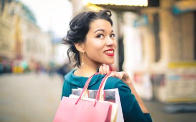 Beautiful woman doing shopping in a city