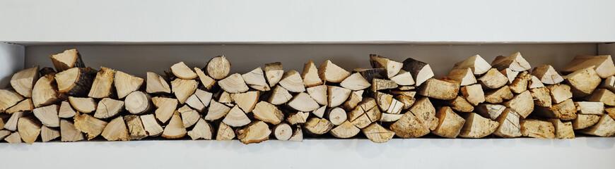 Photo sur Aluminium Texture de bois de chauffage wall firewood, Background of dry chopped firewood logs in a pile