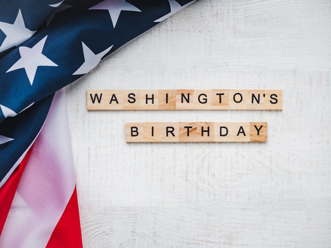 Washington's Birthday, Presidents' Day. Beautiful greeting card. White, isolated background, close-up, top view, wooden surface. Congratulations for loved ones, relatives, friends and colleagues