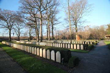 Gravestones and statues on the military field of honour at the Grebberberg in the Netherlands, where lof of solders felt in 5 days at start of world war II