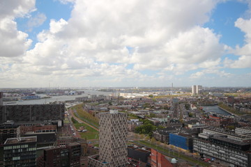 Overview over the city of Rotterdam in the Netherlands with its harbors and bridges over the river Oude Maas.