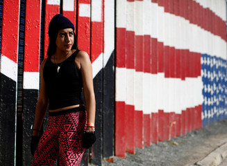 The Wider Image: U.S. films, hip hop inspire young immigrants' 'American dream'