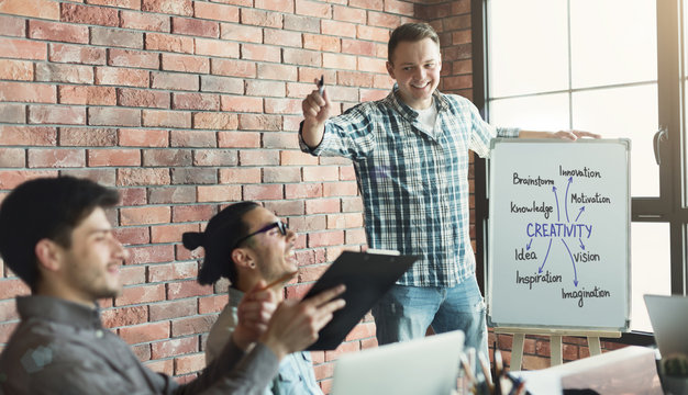 Team leader presenting creativity meaning to coworkers