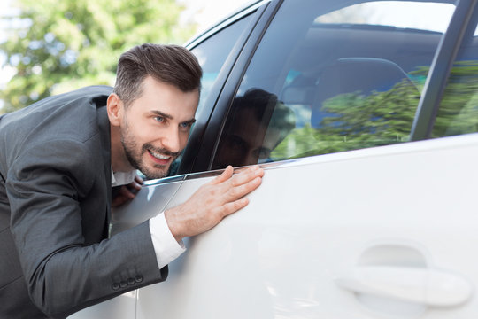 Business man obsessing about cleanliness of car