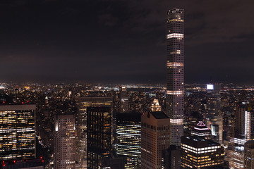 aerial view of buildings and night city lights in new york, usa