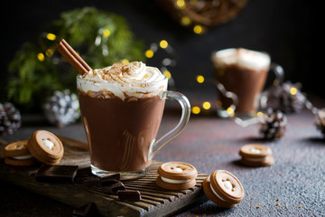 Foto auf Acrylglas Schokolade Traditional winter dishes. Traditional drink Christmas or New Year. Mug of hot and spicy aromatic chocolate with whipped cream on top.