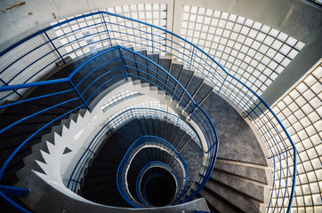 Beautiful and hypnotic spiral convoluted staircase, wide angle Wall mural