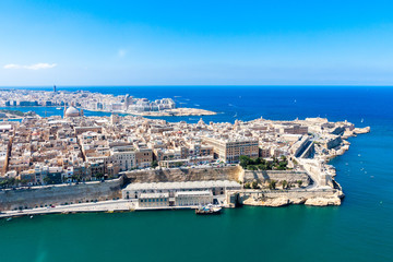 Historical Valetta, capital city of Malta, Grand harbour, Sliema town, Marsamxett bay from above. Skyscraper in Paceville district is in the background. Malta aerial view