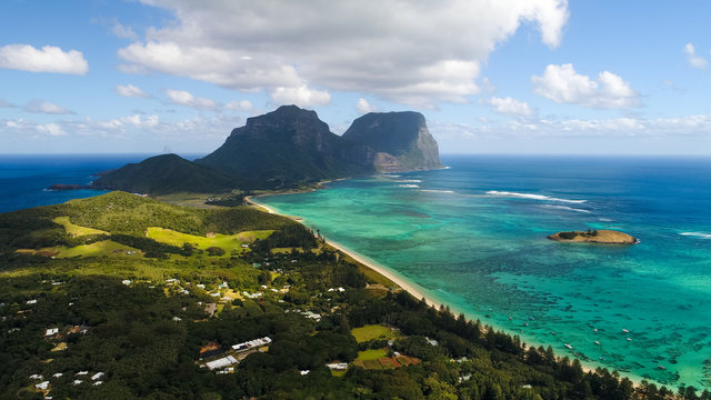 Aerial view of Lord Howe Island (World Heritage-listed paradise), turquoise blue lagoon and Mount Gower on background - New South Wales - Tasman Sea - Australia from above