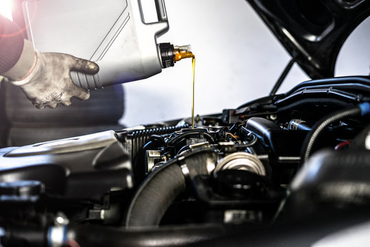 OIL CHECK // Mechanic fills up the engine with engine oil