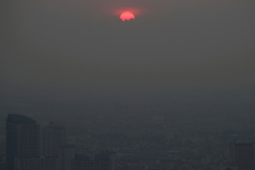 The sunset is seen during a poor air quality day in Bangkok