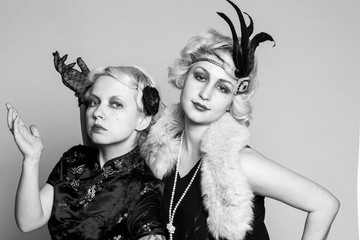 Black and white retro portrait of two girls-blondes