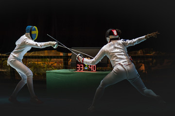 Two man fencing athlete fight on professional sports arena