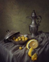 Still life with lemon and olives