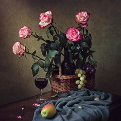 Still life with bouquet of pink roses and red wine