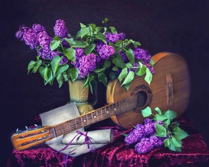 Still life with bouquet of lilac and guitar