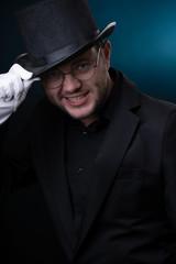 Image of happy man in black hat in white gloves