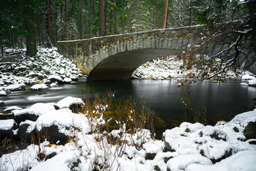 Pohono Bridge in Snowy Winter, a Stone Archway over the Merced River in Yosemite National Park