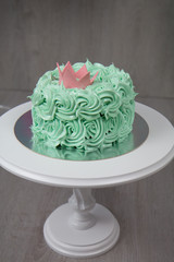 Green cake with crown decor.