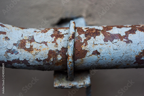 Shabby Old Metal Pipe With Fastening Stock Photo And Royalty Free