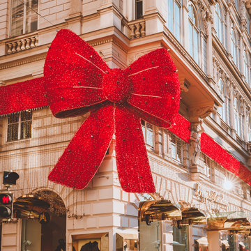 Giant decorative red Christmas bow on building