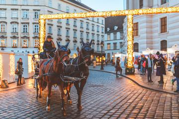 Hackney cab on Christmas market at Hofburg Palace in Vienna