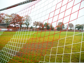 Red and white goal net of Rural soccer pitch in Germany