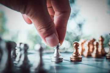 Hand playing Chess game, Chess game competition business concept , Business competition concept Fighting and confronting problems.