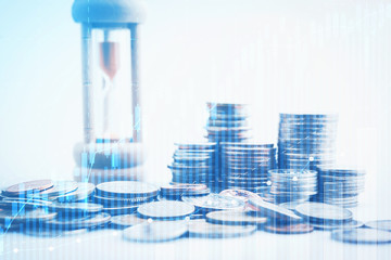 sandglass and rows of coins for time of finance and business concept