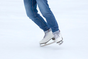 feet rolling on skates woman on the ice rink