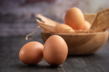 Brown eggs on old wood table. copyspace for your text