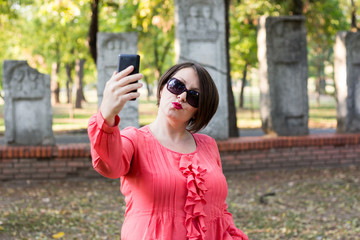 Girl Posing and Taking Selfie in a Park