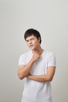 Man has a terrible pain in throat because of flu. He lost his voice and can not speak