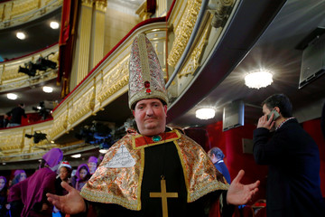 """A man dressed as a bishop attends the draw of Spain's Christmas Lottery """"El Gordo"""" in Madrid"""