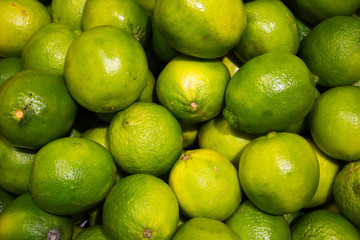 pile of limes at supermarket