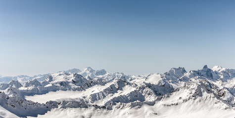 Wall Mural - White snowy winter Caucasus mountains at sunny day. Panorama view from ski slope Elbrus, Russia