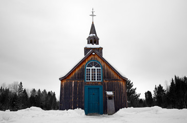 Old style little church abandoned in the winter