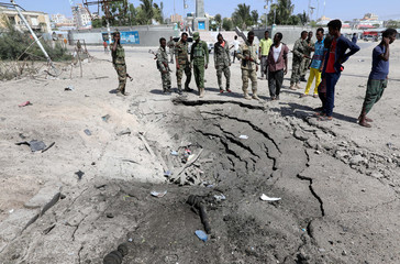 Somali security forces stand at the scene of an explosion near president's residence in Mogadishu