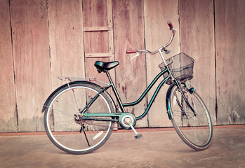 vintage bicycle on old wall / old bike on wall wooden house background